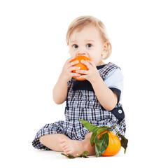 cute toddler eating orange