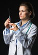 Doctor woman using syringe on black background