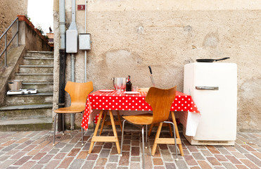 dining table with refrigerator in a street of village