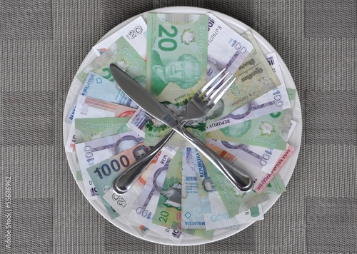 Plate with international currencies, knife and fork
