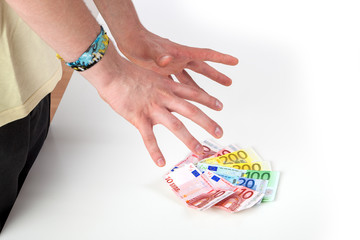Hands reach for banknotes on the table