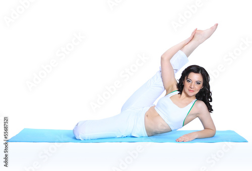 young woman in yoga pose on isolated