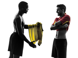 two men soccer player  exchanging jersey standing silhouette