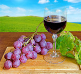 grape and wine on a chopping board