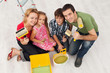 Happy family redecorating their home - painting