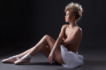 Charming young ballerina posing topless in studio