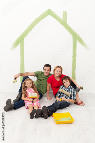 Happy family with kids redecorating their home