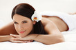 Spa Woman. Beautiful young woman relaxing after massage. Spa sal