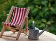 canvas print picture - Metallgießkanne und Liegestuhl im Garten
