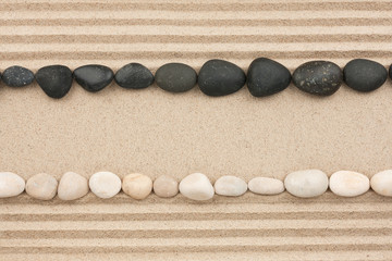 White and black stones lying on the sand