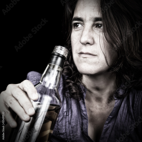 Drunk latin woman drinking from a whiskey bottle