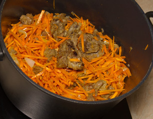 Pilaf, meat carrots and spices.