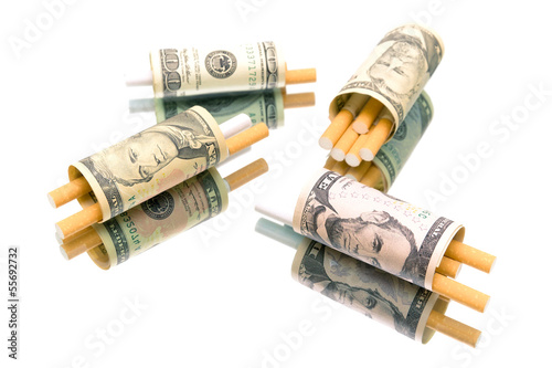 money and cigarettes on white background