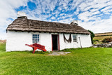 Traditional thatched cottage at Cregneash in the Isle of Man
