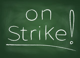 "The school board on which is written in chalk ""on strike"""