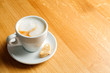 cappuccino cup on wooden table