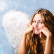 Merry Christmas: romantic young woman as an angel
