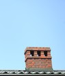 Chimney on the roof sky background