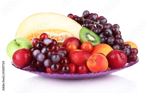 Assortment of juicy fruits isolated on white