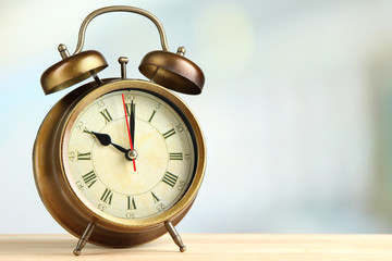 Old alarm clock  on bright background