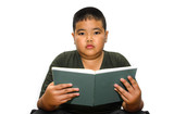 Boy reading a book , isolated over white