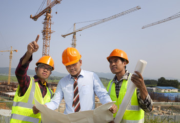 Architect and construction workers discussion on site