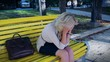 Depression and problems of blond female in park, crying tears