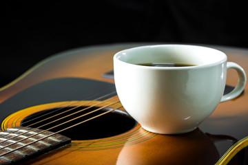 Steel string acoustic guitar with coffee cup