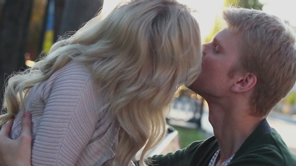 Closeup of private couple kissing romantic date in park outdoors