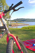 On the shore of the lake with the mountain bike