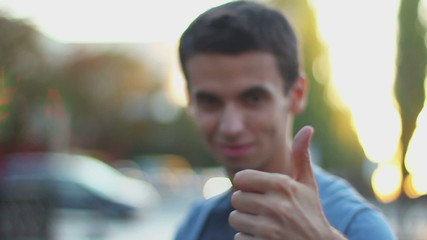 Young man thumb up, like, thumb-down, dislike gestures, wants