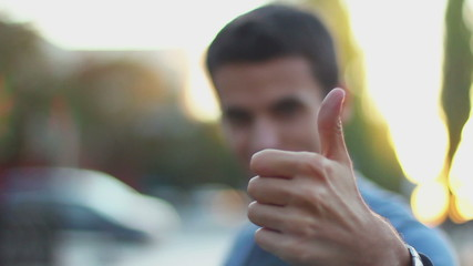 Thumb up, unrecognizable young man outdoors, like, take, buy