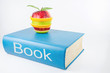 Book and an fruits on a white background