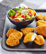 chicken nuggets and fresh vegetable salad