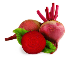 Raw beet vegetables with slice and green leaves isolate on white