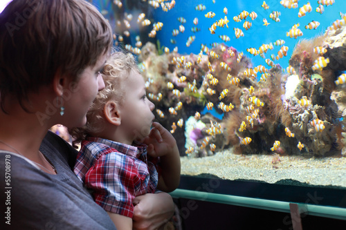 Mother with child at aquarium
