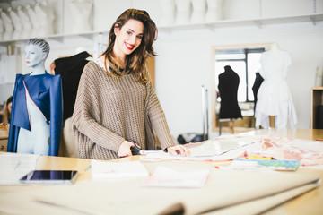 Fashion designer working in the studio