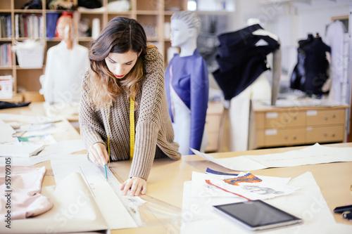 Leinwanddruck Bild Fashion designer working in studio
