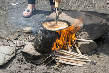 making pancake on the campfire