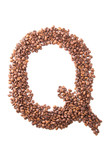 Letter Q, alphabet from coffee beans on white background