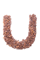 Letter U, alphabet from coffee beans on white background