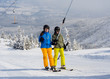 Teenage girl and boy skiing