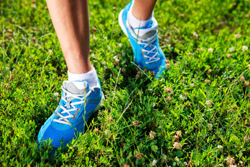 Running shoes on grass.