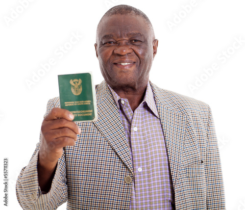 senior south african man holding ID book
