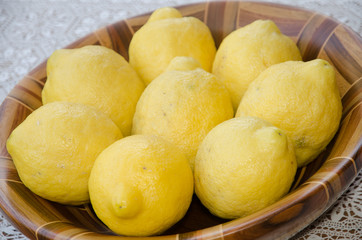 lemons in the fruit bowl on wood