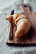 Croissant on a wooden kitchen board
