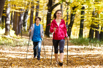 Nordic walking - active young people outdoor