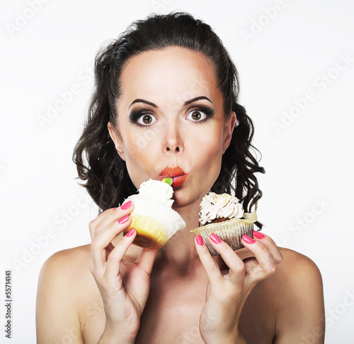 Gluttony. Hungry Funny Young Woman Greedily Eat Cakes with Cream