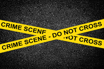 CRIME SCENE - DO NOT CROSS against black wall