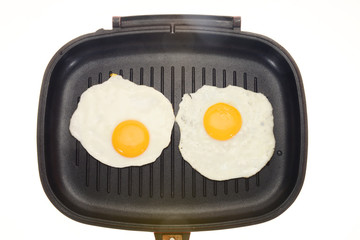 Cooked  Eggs In A Frying pan